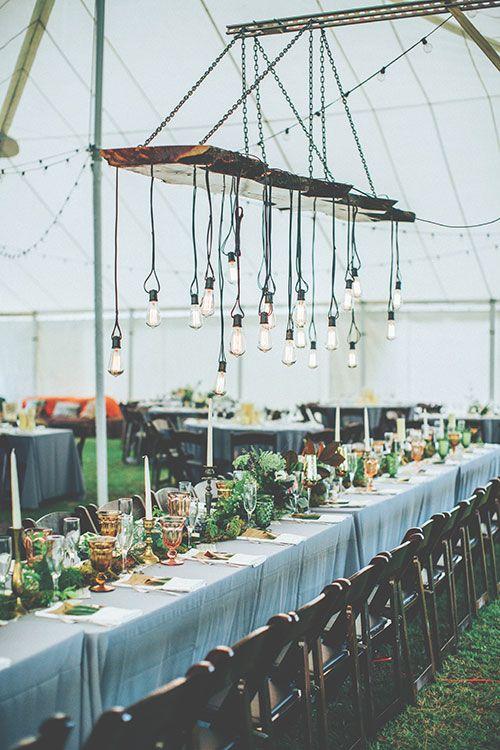 A filament bulb chandelier is a unique way to light a wedding reception | Brides.com