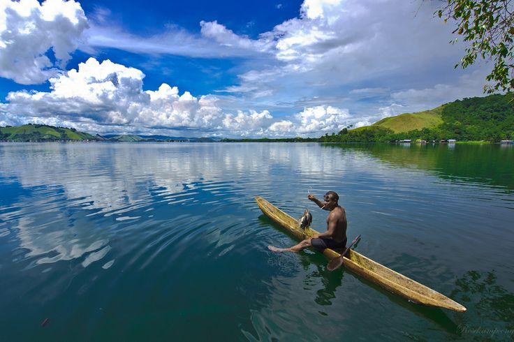 Fishing at a Blazing Days In The Lake Sentani by Rose Kampoong