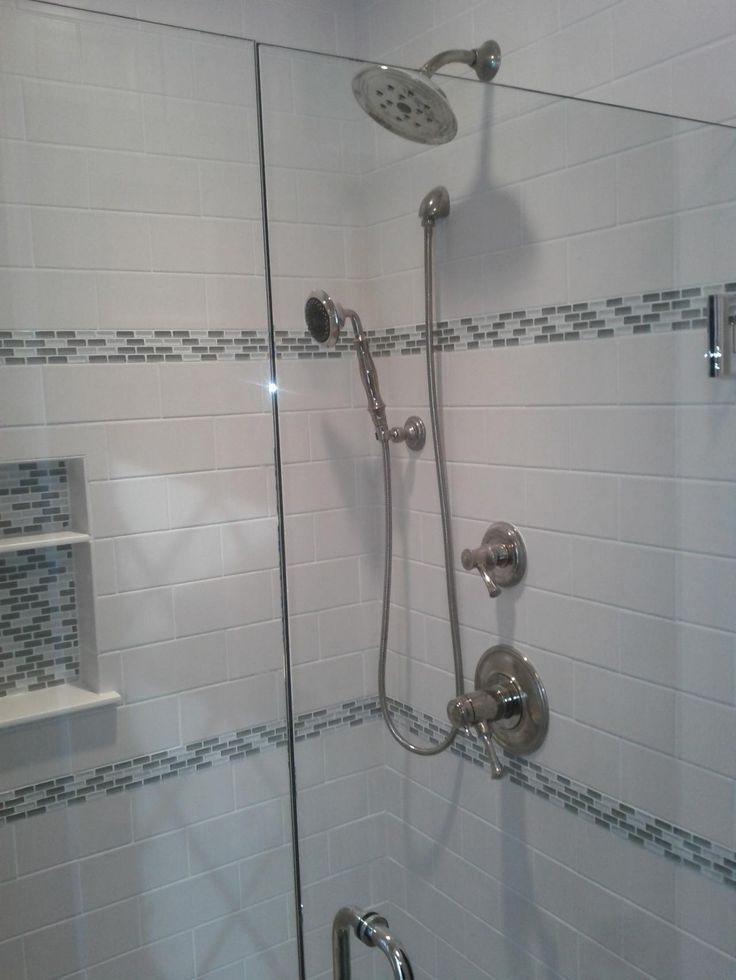 This picture shows a glass tile accent strip in an Edina ceramic subway shower.