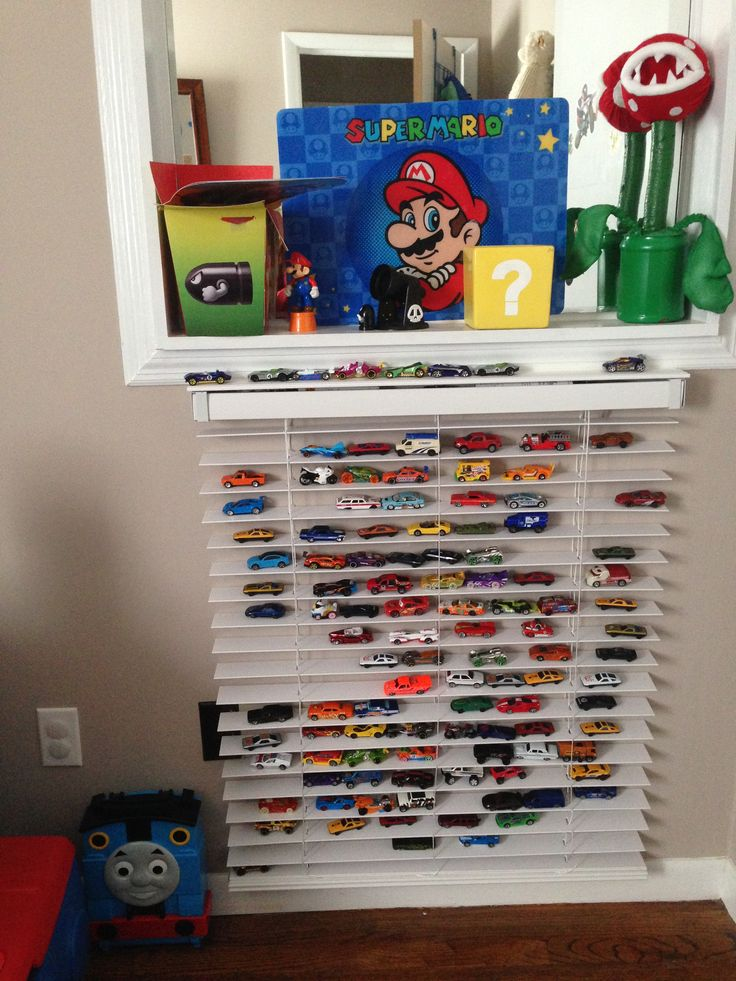 Use wood blinds on a wall for hot wheel car storage and display
