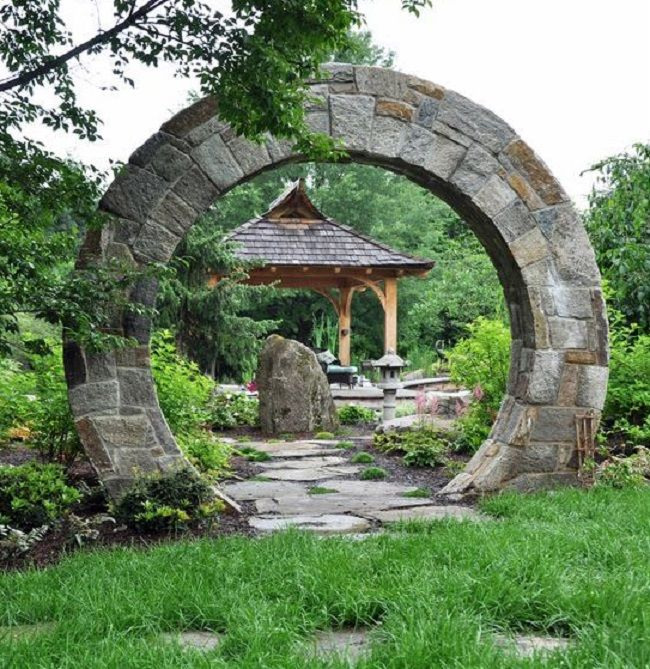 "The moon gate frames the pagoda style pavilion and the ""good karma"" boulder. Masons hand chiseled each stone on site and set the stone against a wooden arched form which was later removed. By McHale Landscape Design, Upper Marlboro, MD."