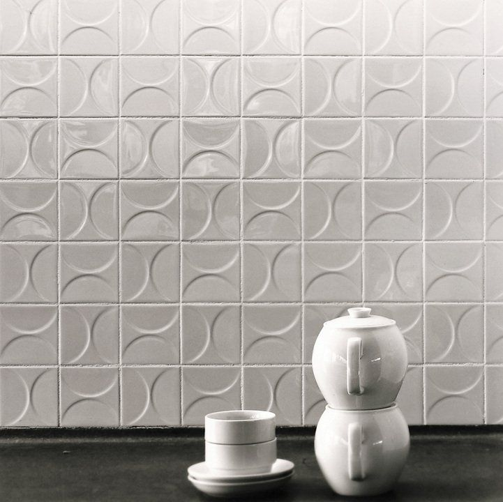 The Kho Liang Ie Collection futures gloss white tiles with relief of circles, segments of circles diagonals and triangles, design by interior designer Kho Liang. Tiles available in a 10 x 10 cm format and in 7 different patterns.