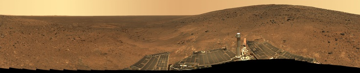 "Gusev Crater 'Independence' panorama taken by the Mars Spirit Rover near the summit of ""Husband Hill,"" to the right in this image. Taken on Martian mission days Sol 536 through 543 (July 6-13, 2005 on Earth)."