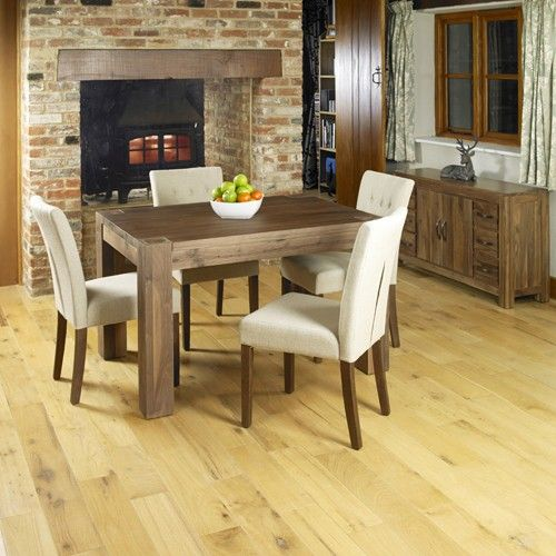 Get your dining room ready for Christmas with the stunning Mayan Walnut four seat dining table with coordinating cream upholstered chairs.