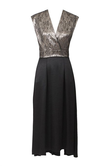 The Kismet Cross front evening dress is slick dress silhouette with a modern feel cut in Italian crushed metallic cloth. The lustrous satin twill skirt with soft tucks and pockets is a fluid shape with a semi fitted bodice. The classic silhouette and ladylike length make it a go to style for seasons to come. Work it with a wrapped ankle boot and python Sonic clutch and Encase belt for super chic evening wear. #GingerandSmart