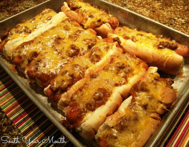 Baked Chili Cheese Dogs 8 bun-length hot dogs 8 hot dog buns 1 15-oz. can chili without beans (such as Hormel) 2 cups shredded cheddar cheese