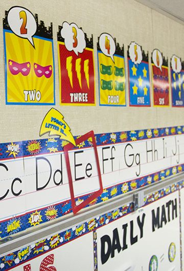 """Superhero Alphabet Line Bulletin Board Display Set - Your """"super"""" learners will love this bright and colorful alphabet line. The frame and lightning bolt pieces provide a fun way to highlight a letter or number of the day. Includes numbers 0-10. Also includes a teacher's guide with suggested activities."""