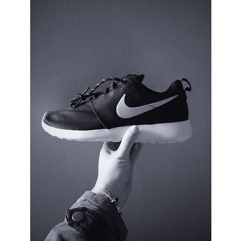 8866ca87a1df Trophy like in their design. The Nike Roshe Run in black and white ...