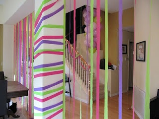 Decorating with crepe paper streamers.