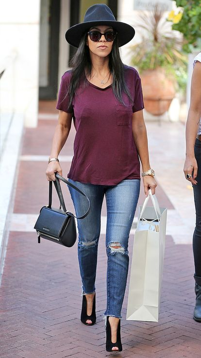 Try out distressed skinny jeans, peep toe booties/pumps, a classic burgundy v-neck tee, black shoulder bag, bracelet watch, and a wide brim hat