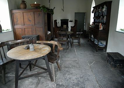 Welsh cottage interior with box bed and superb Elm cricket table...St. Fagans, Museum of Welsh life. Cardiff