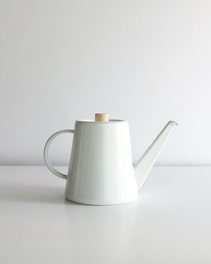 Enameled steel pour over kettle with turned maple accents. Functions beautifully as a pour over kettle as well as a basic hot water kettle. The heavy gauge steel conducts heat superbly and is a breeze