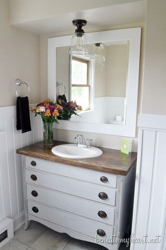 Pretty bathroom makeover with DIY dresser turned vanity. @Traci @ Beneath My Heart