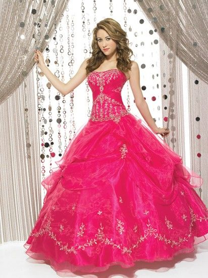 A full skirted pink ball gown from Allure Prom.