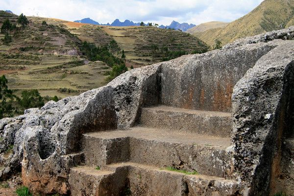 From Pumacaca, a shrine (wanka) of the Inca culture, carved into a limestone outcrop, at the Chinchero ruins - to the terraced agricultural slopes along the Vilcanota Range - to the distal jagged peaks along the Urubamba Range - Cusco department.