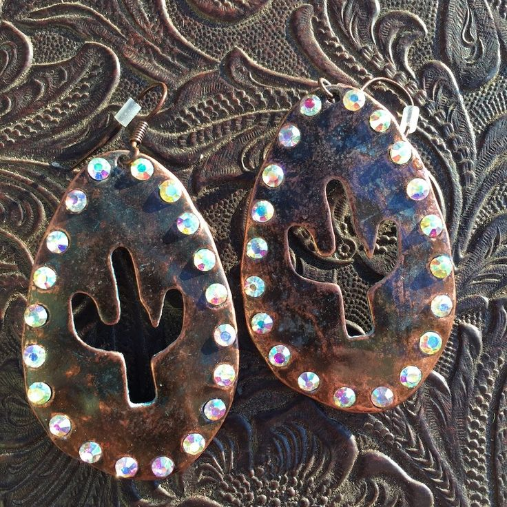 """Cactus Bling earrings available in serape, bronze, native, and silver. Dimensions: - Pendant - 2"""" X 1.25"""""""