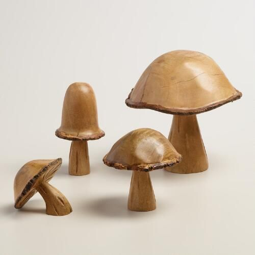 Our decorative mushroom is hand carved from a single log of wood and features rustic bark edging, making each one truly unique. Cluster several together on the mantle or dining table or display separately on shelves.