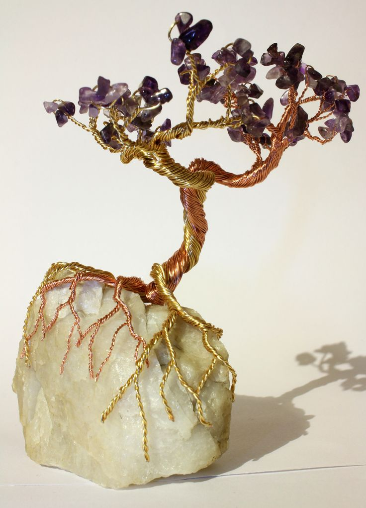 Amethyst tree on quartz with copper and gold coloured copper wire