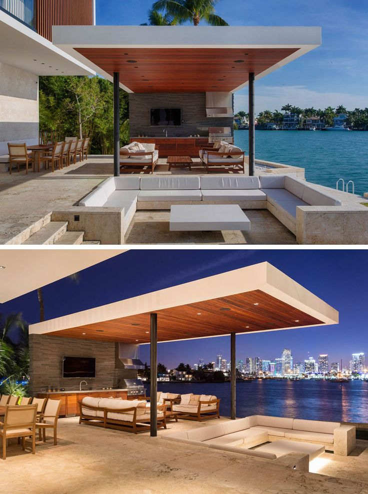 This modern house has a covered outdoor entertaining area with a sunken lounge, an outdoor kitchen, a second covered lounge and a dining space.
