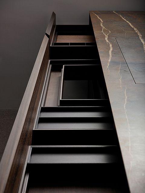 Velia by Minotticucine - Natural stone + dark anodized and bronzed aluminium accessories.