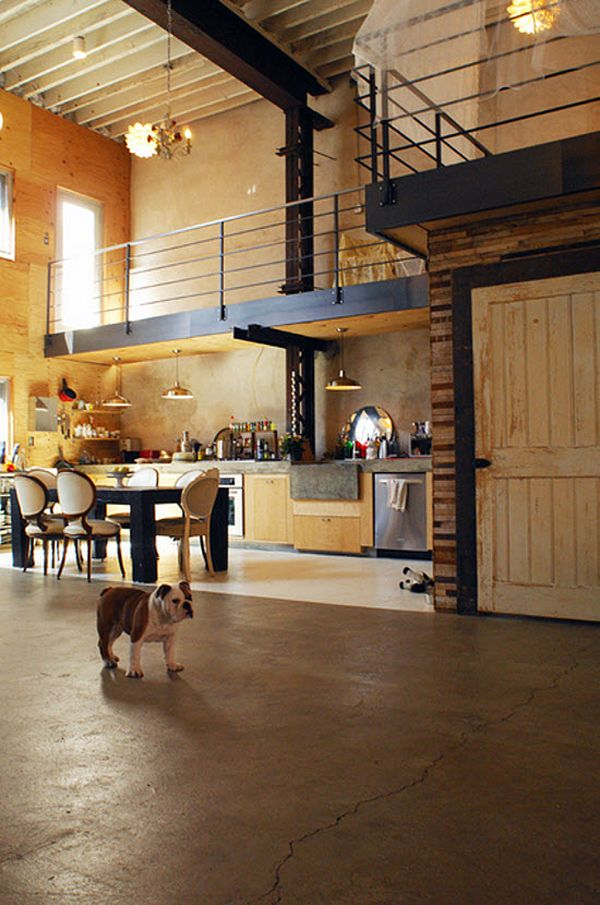 Raw industrial loft warehouse space, mixed materials, wood, metal, brick, concrete, interior wrap around second level