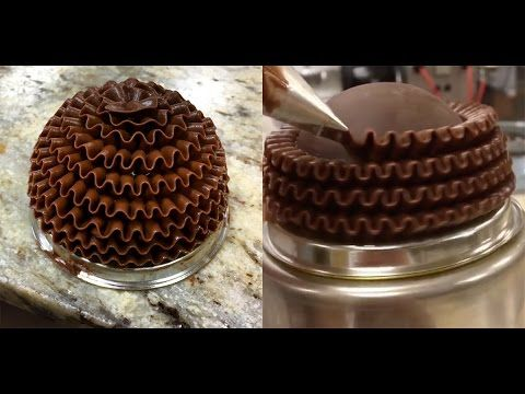Piping a basket weave pattern in buttercream. This is a time lapse video where each frame is 2 seconds. It really took an hour to pipe this. The final cake w...