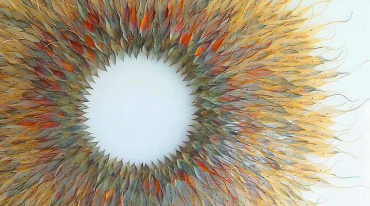 individually cut pieces of metal, cut and colored by U.K. artist Michelle Mckinney