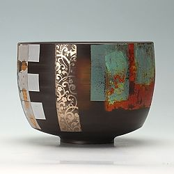 This is a thrown and turned black porcelain bowl by Tony Laverick.