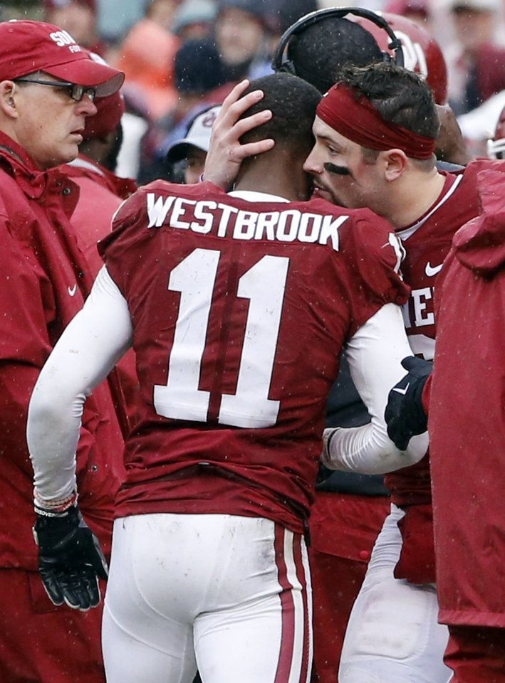 Oklahoma's Baker Mayfield (6) greets Dede Westbrook (11) as he leaves the field following a hard hit during the Bedlam college football game between the Oklahoma Sooners (OU) and the Oklahoma State Cowboys (OSU) at Gaylord Family - Oklahoma Memorial Stadium in Norman, Okla., Saturday, Dec. 3, 2016. Photo by Steve Sisney, The Oklahoman