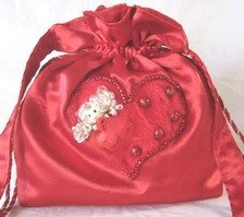 satin bag with heart design and pearls to match.