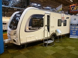 """New Coachman Pastiche 545 2013 Caravan,   Price: £21495.00 + Delivery Charges.  Berth: 4  Year: 2013.  Internal Length: 19ft.  External Length: 24ft 6"""".  Width: 7ft 7"""".  Unladen Weight: 1465kg.  MTPLM: 1625kg."""