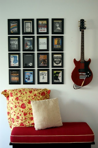 Hang your guitar on the wall for easy access.  Frame your favorite album cover artwork to add to the display.
