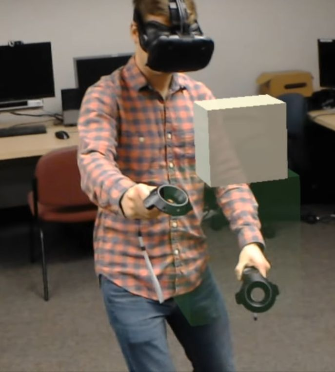 Watch and interact with virtual reality wearing Microsoft's mixed reality headset.