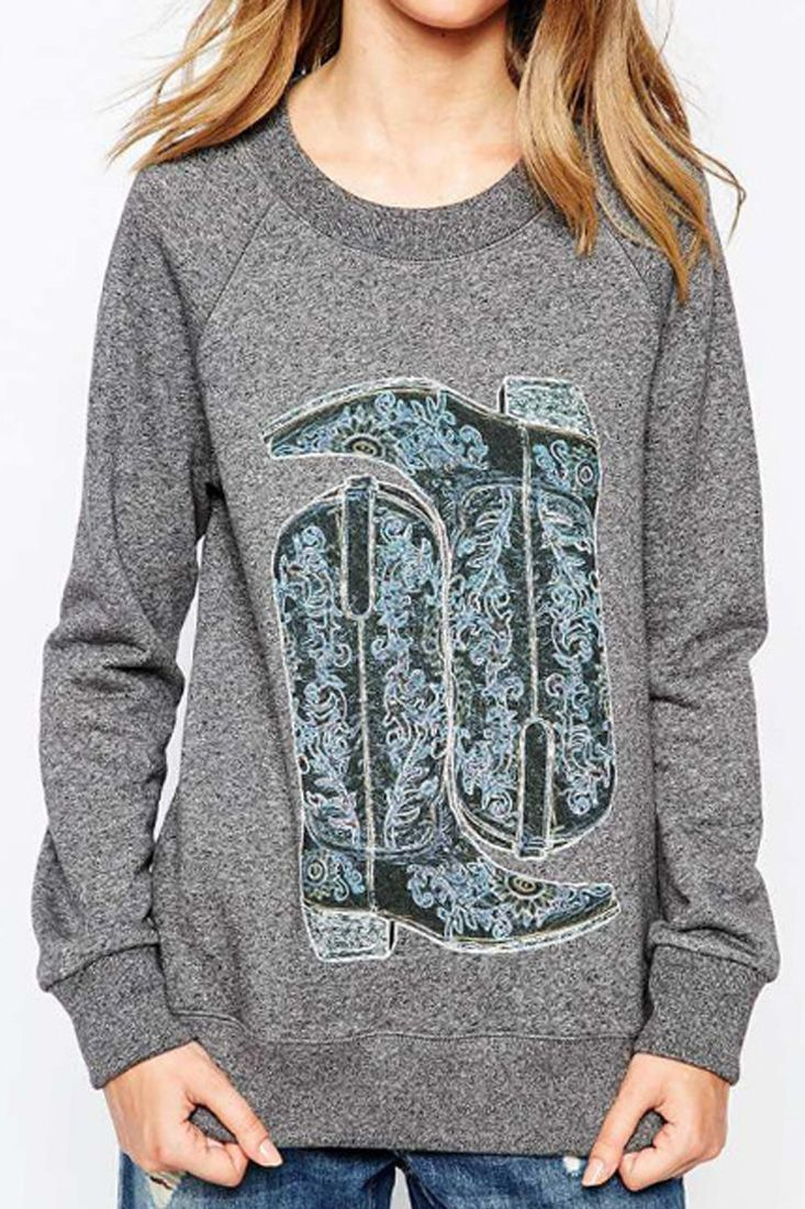 The sweatshirt is featuring boots pattern. Long sleeve. O neck. Loose fit.