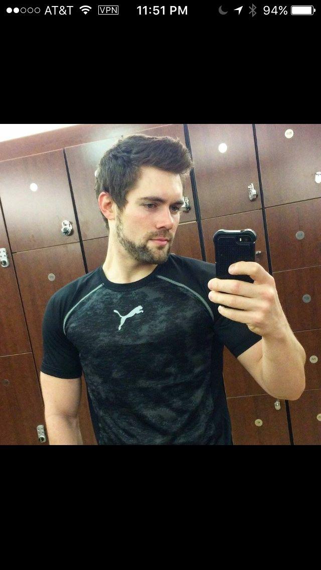 Handsome locker room mirror selfie