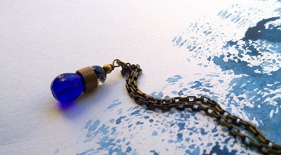 Antiqued Brass and Indigo Blue Bead Drop Charm Necklace