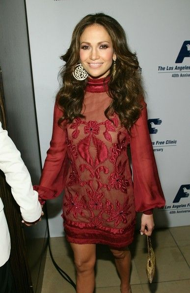 Jennifer Lopez Cocktail Dress Jennifer Lopez looked ravishing in a long sleeved red chiffon dress embroidered with flowers