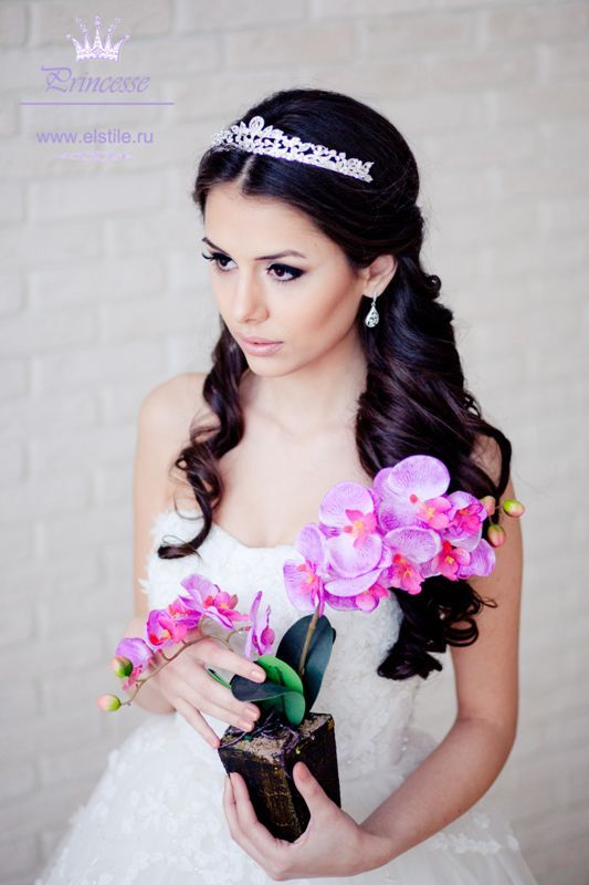 Wedding hairstyle with a tiara for long curls. Maybe my hair will be long enough to do something similar.