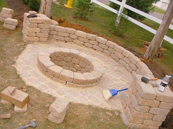 DIY fire pit. around 200 for pit and wall and pillars