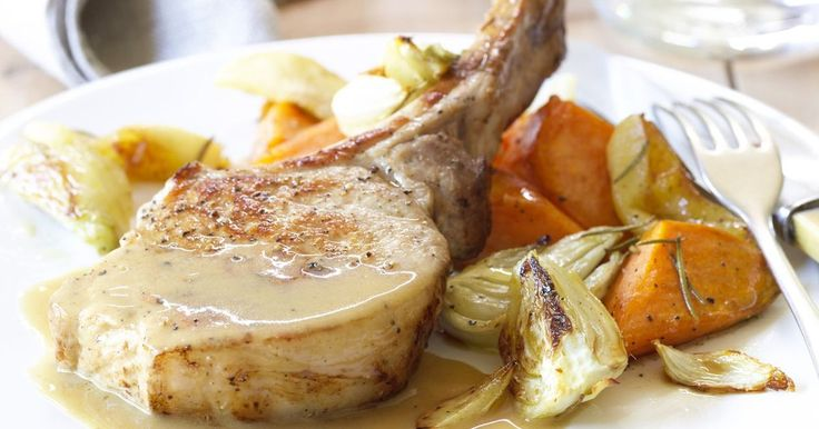 Succulent pork cutlets with seasonal rosemary roasted apple, fennel and sweet potatoes by Curtis Stone.