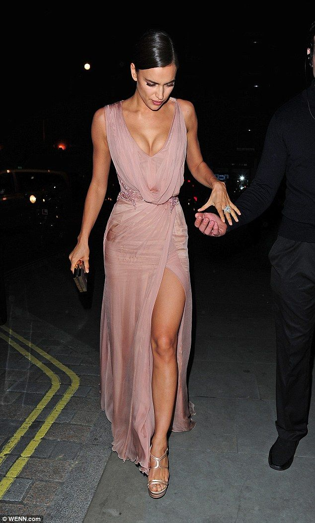 Stand by your man: Irina Shayk wowed in a plunging blush pink dress with a thigh-high split as she supported her boyfriend Bradley Cooper at a performance of The Elephant Man in London on Tuesday