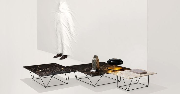Oki tables from Walter Knoll. Designed by EOOS. Top in marble.