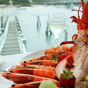 Boasting sweeping views across Wollongong's boat harbour, the tri-level Harbourfront Restaurant is stunning both night and day