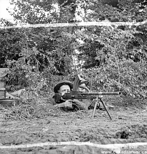 Caen - Carpiquet - An unidentified Bren gunner of the 8th Canadian Infantry Brigade, Carpiquet, France, 4 July 1944.