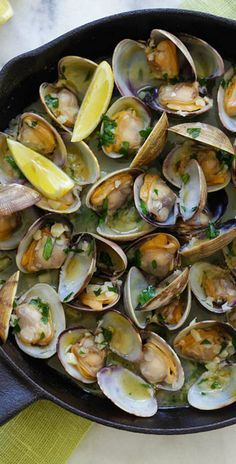 Sauteed Clams – Skillet clams with loads of garlic butter, white wine and parsley. The easiest sauteed clams recipe ever, 15 mins to make | http://rasamalaysia.com