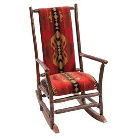 """Hickory rocking chair with Southwestern-inspired upholstery. Handcrafted in the USA.   Product: Rocking chairConstruction Material: Hickory logs and fabricColor: RedFeatures:  Individually handcraftedClear coat catalyzed lacquer finish for extra durabilityUpholstered seat and back for superior comfort All hickory logs are bark on and kiln dried to specific moisture contentDimensions: 44"""" H x 25"""" W x 36"""" D"""