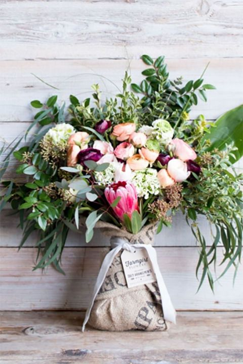 Farmgirl Flowers:  Farmgirl Flowers has made a name for itself with its trademarked burlap wrapped bouquets, which add that perfect country touch to floral arrangements. They also offer some lovely vases if you need a container for your flowers, including this $15 galvanized vase.