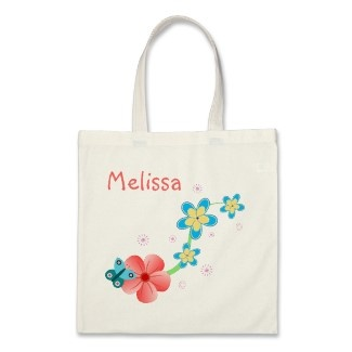 Butterfly on Pink and Blue Flowers Budget Tote Bag by sunnymars  More Custom Tote Bags     This sweet, cute budget tote bag features a graphic cartoon vector illustration floral design of an abstract butterfly sitting on a pink hibiscus tropical flower with other blue and yellow daisy like flowers above. Personalize it by adding your own name or other text to it.