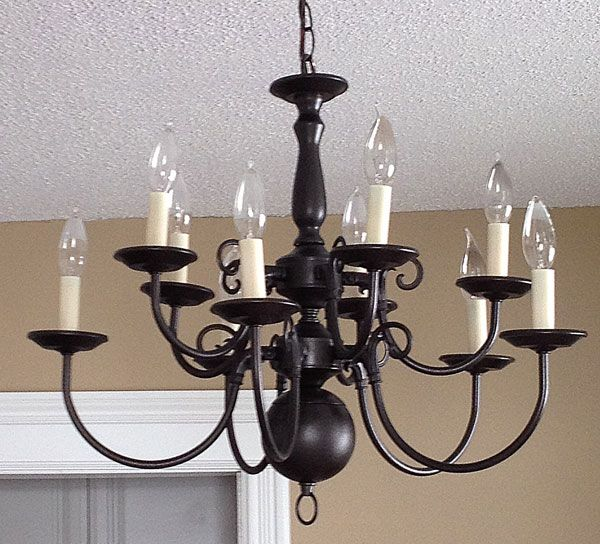 Let there be Light! - Chandelier makeover from brass to beautiful! Total cost $30! Purchased from Habitat for Humanity and spray painted.