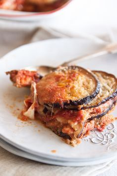 A recipe for melanzane alla parmigiana, aubergine or eggplan parmigiana: fried aubergines baked in the oven with cheese and tomato.